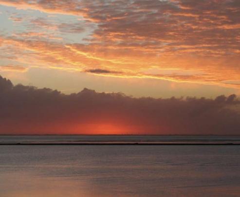 Foto zonsondergang Waddenzeegebied